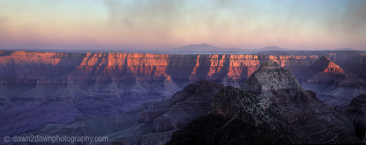 The sun sets on the Grand Canyon as seen from The North Rim at Grand Canyon National Park, Arizona