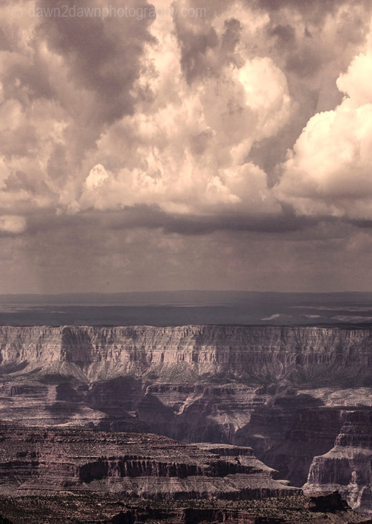 Storm clouds pass over the Grand Canyon as seen from Timp Point, Kaibab National Forest, Arizona