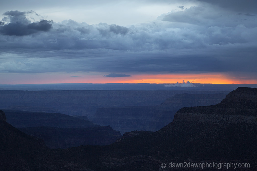 Storm clouds pass over the Grand Canyon near sunset as seen from Timp Point, Kaibab National Forest, Arizona