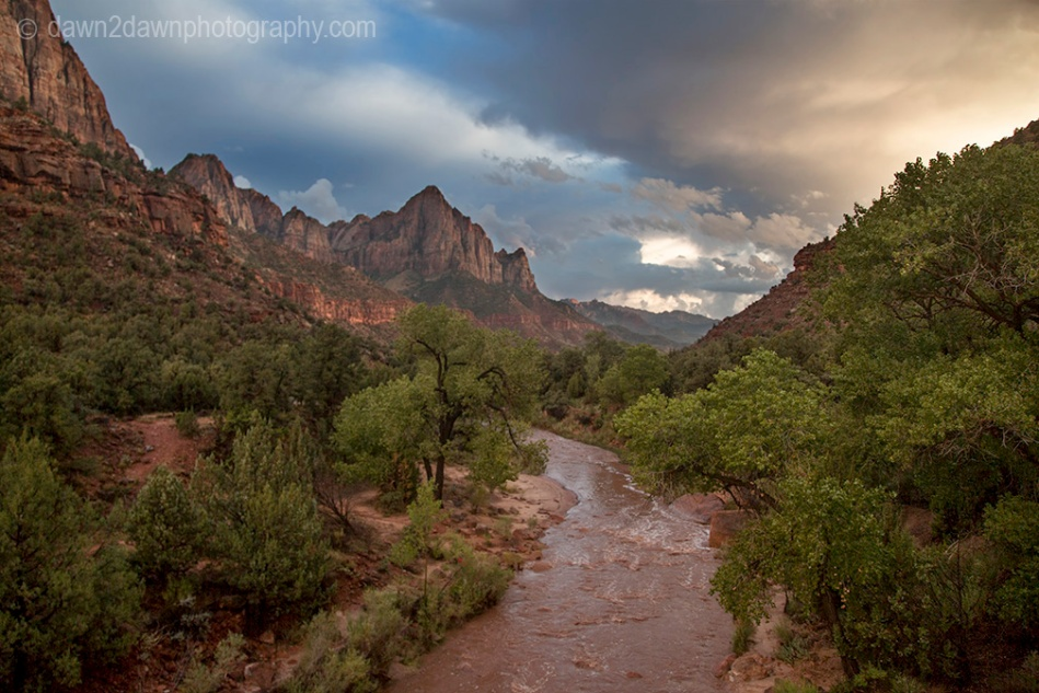 The light from the setting sun shines on the West Temple at Zion National Park, Utah