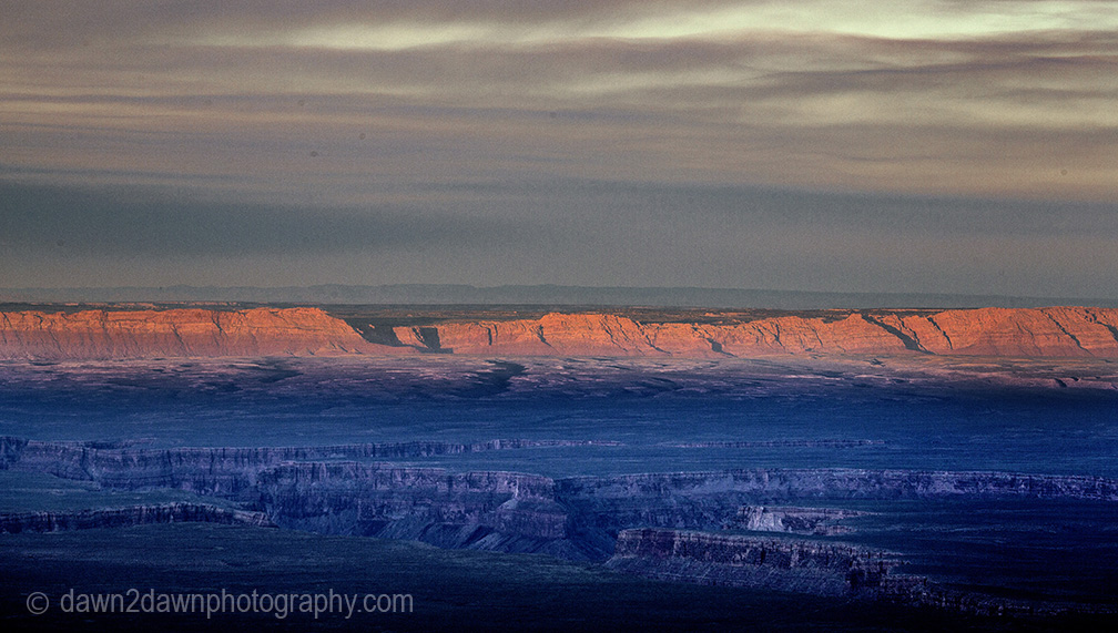 The light from the setting sun shines on Marble Canyon at Grand Canyon National Park, Arizona.