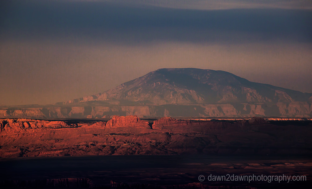The light from the setting sun shines on Marble Canyon and Navajo Mountain at Grand Canyon National Park, Arizona.