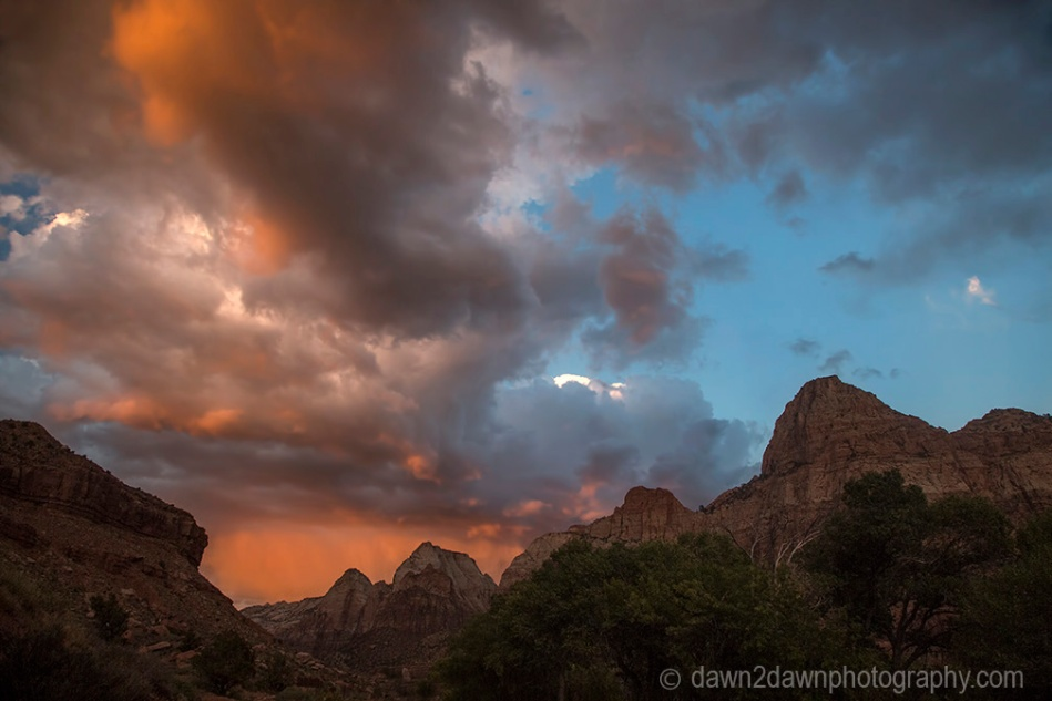 The sun sets on Zion Canyon and some stormy clouds at Zion National Park, Utah
