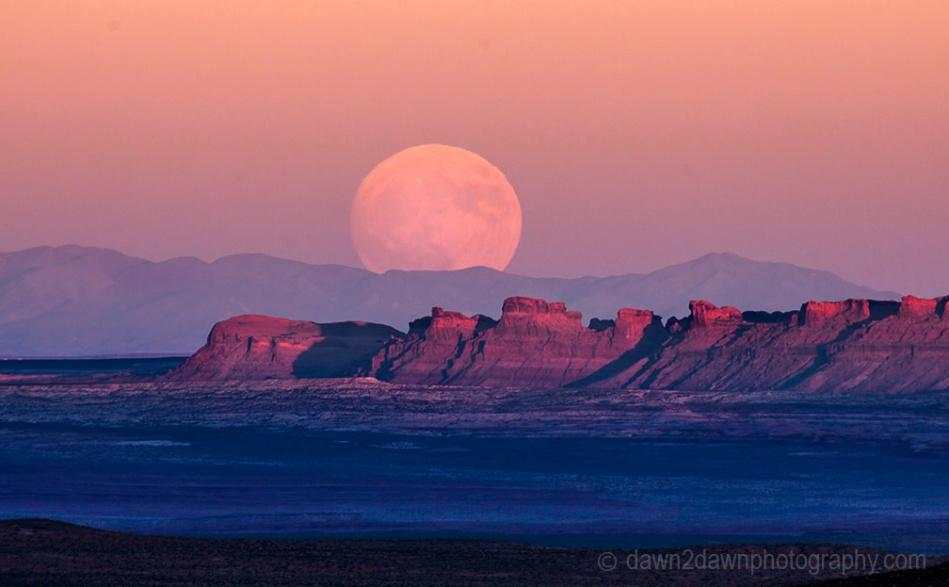The full moon or supermoon rises over Monument Valley on Navajo Tribal Land on the Utah/Arizona border.