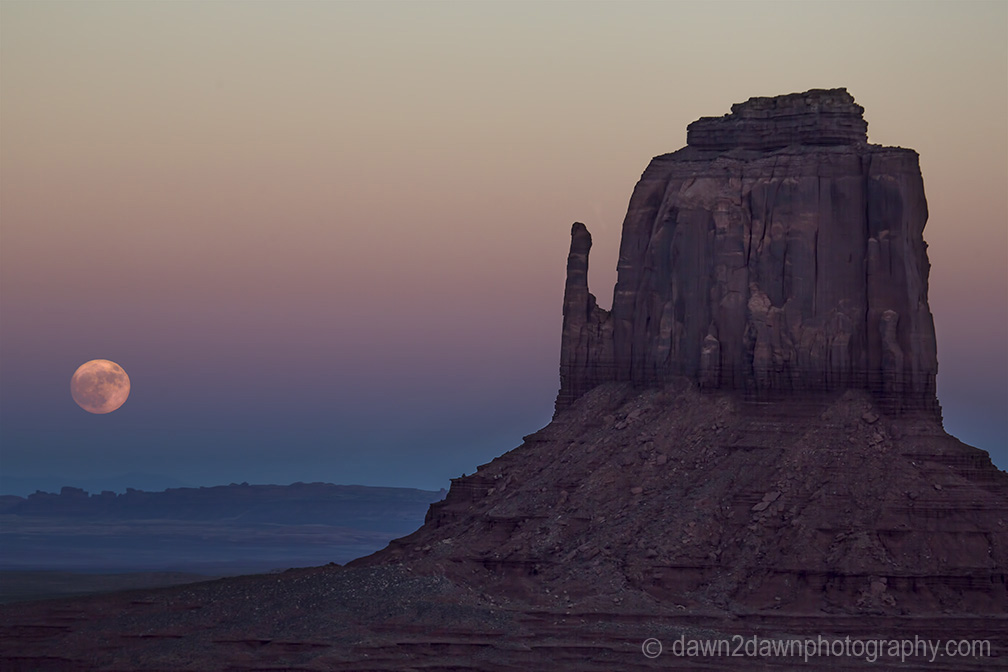 The full moon or supermoon rises over Monument Valley on Navajo Tribal Land on the Utah/Arizona border.