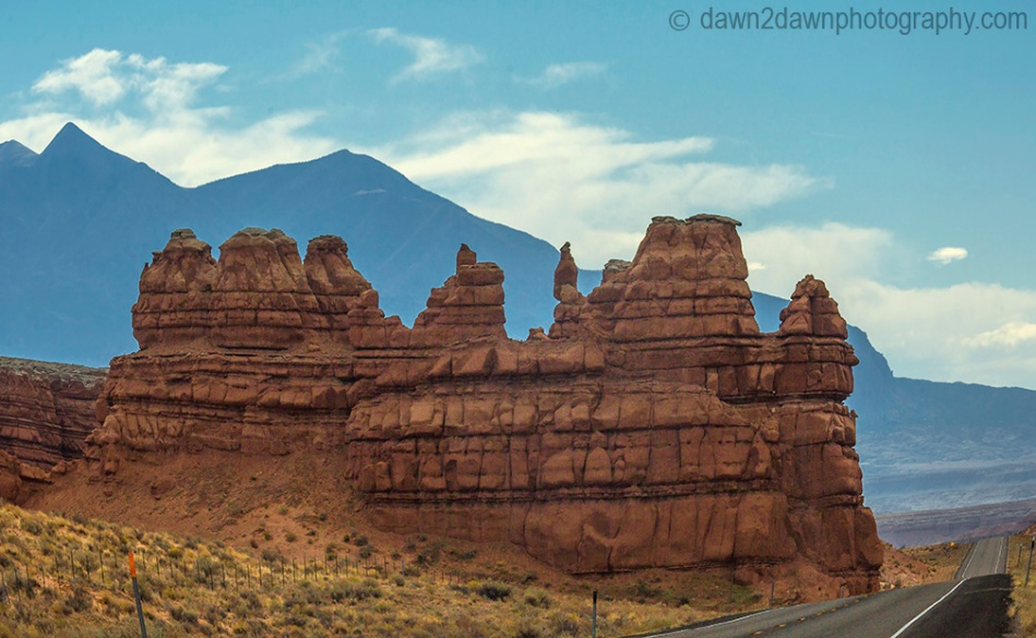 Unusual sandstone rock formations are seen along Utah's rural Highway 24.