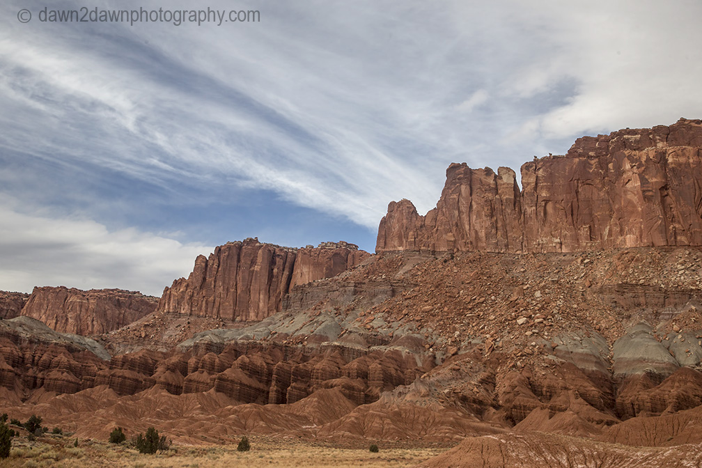 Unusual sandstone rock formations are seen along Utah's rural Highway 24 at Capitol Reef National park.