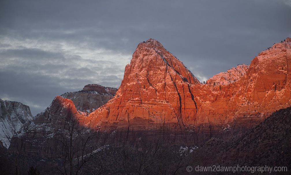 The light from the setting sun shines on Zion Canyon during winter at Zion National Park, Utah