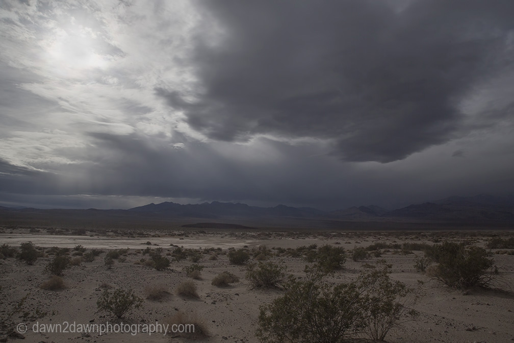 Unusual rainstorms pass through Badwater Basin at Death Valley National Park, California