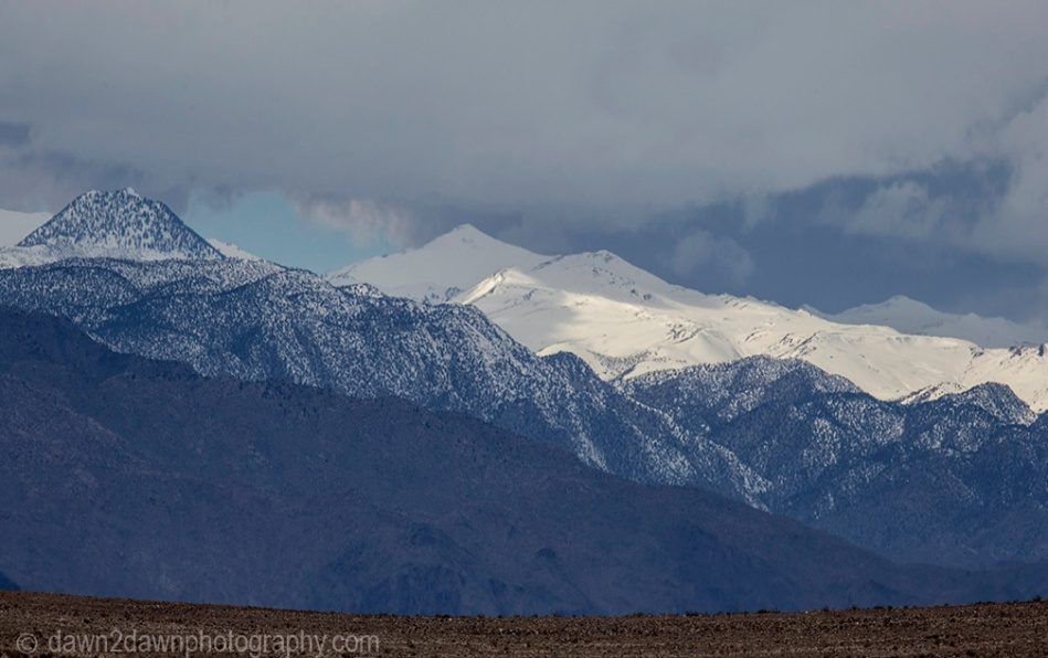 The snow-covered White Mountains as seen from Eureka Valley at Death Valley National Park, California