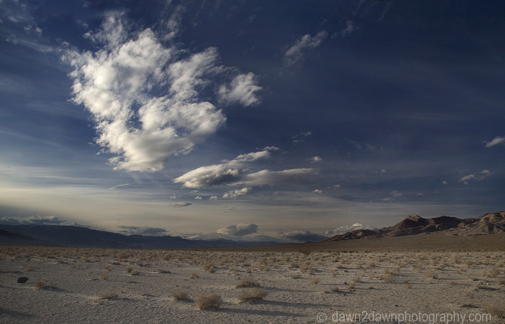Clouds pass over Eureka Valley at Death Valley National Park, California