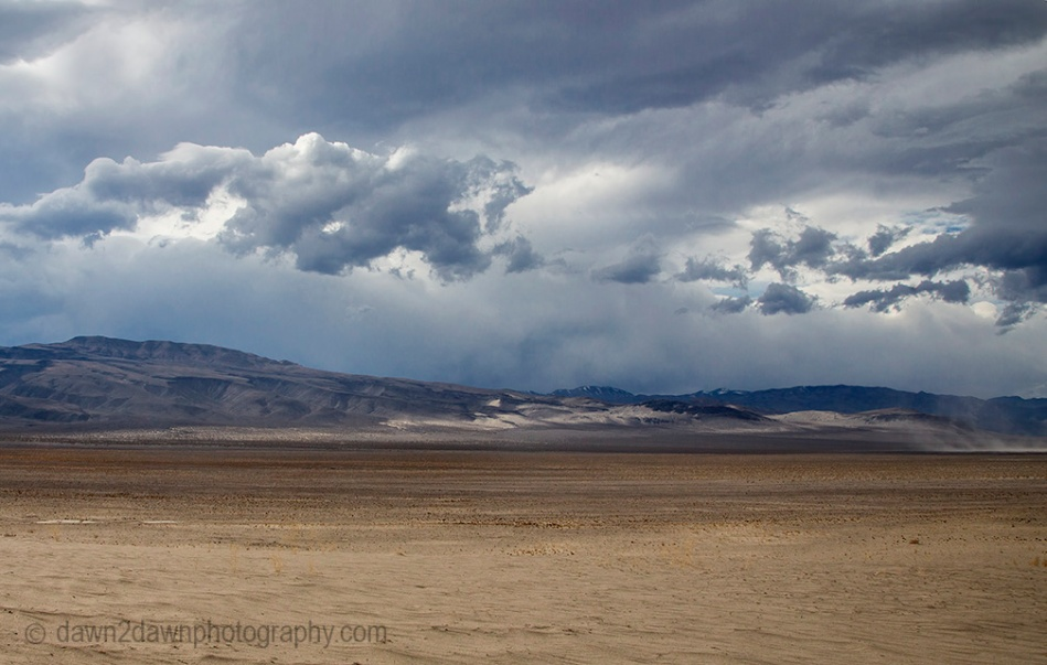 Threatening clouds pass over Eureka Valley during sunset at Death Valley National Park, California