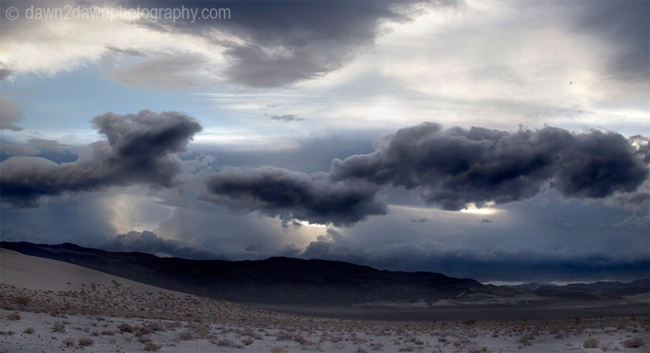 Threatening clouds pass over Eureka Valley at Death Valley National Park, California