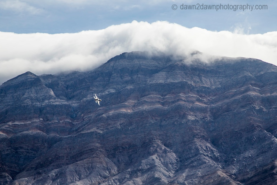 A fighter jet from nearby China Lake Naval Air Warfare Center flies over Death Valley National Park, California