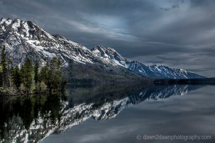 The jagged peaks at Grand Teton National Park are reflected in String Lake .